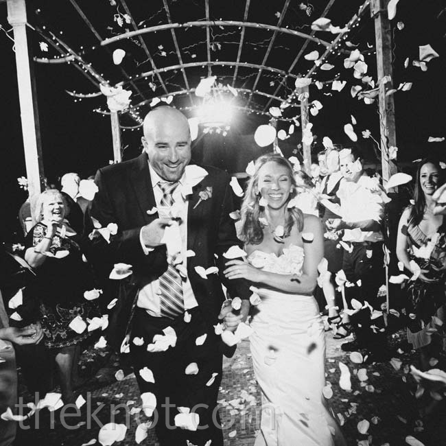 The couple ran to their town car through a shower of flower petals as they left the reception.