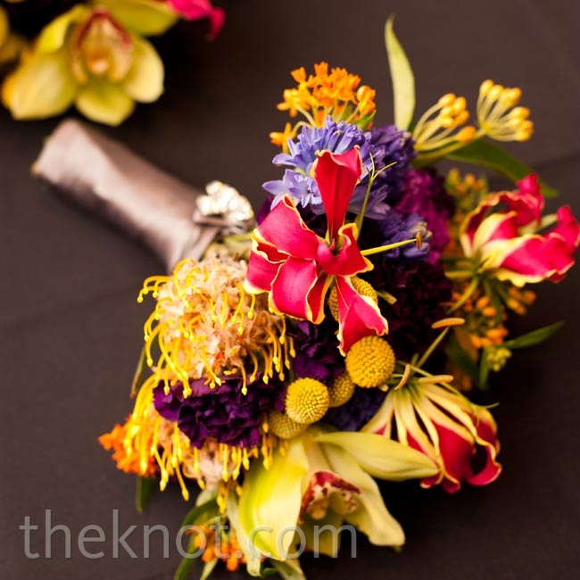 Colorful and exotic flowers like gloriosa lilies, craspedia, pincushion proteas, orchids, and hyacinths created modern bouquets.