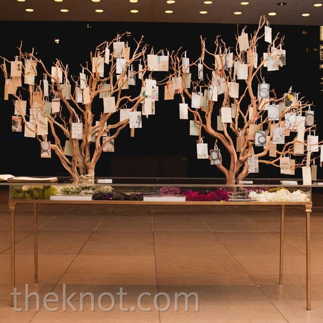 Guests grabbed handmade collages which were draped on two manzanita tress, on their way out.
