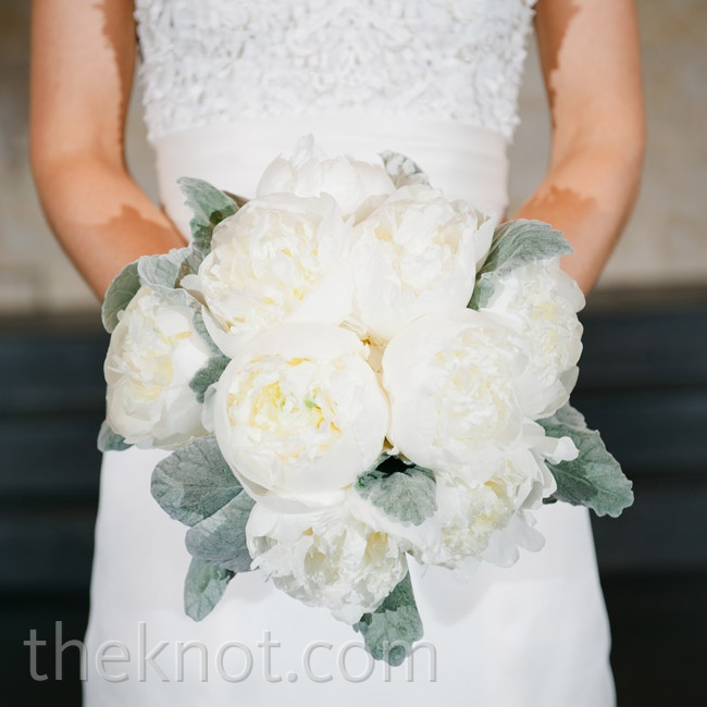 Voluminous white peonies and lamb's ears leaves made Sarah's bouquet undoubtedly wintry.