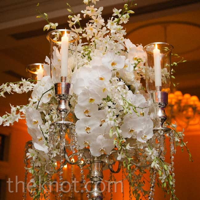 Tall silver candelabras draped with white orchids provided a glitzy focal point on the dinner tables.