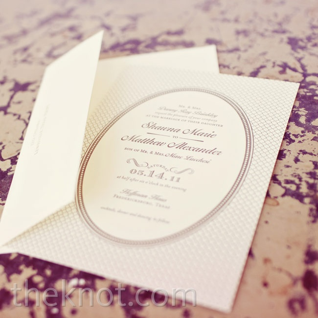 Shawna and Matt chose this invite design to match the oval center stone on her engagement ring.