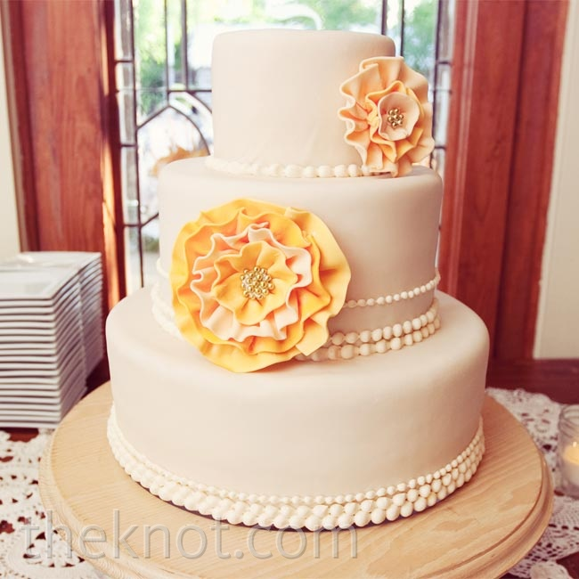 Instead of a topper, Shawna wanted the main feature of the cake to be the peach-fondant rosettes.