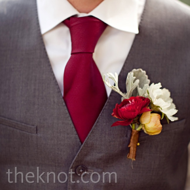 The guys all worse different flowers (such as ranunculus, dusty miller and garden roses) in their boutonnieres.