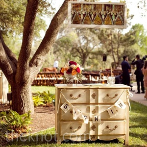 The first thing guests saw as they entered the ceremony space was a hanging stained-glass window and an antique cabinet that held the sign-in book.