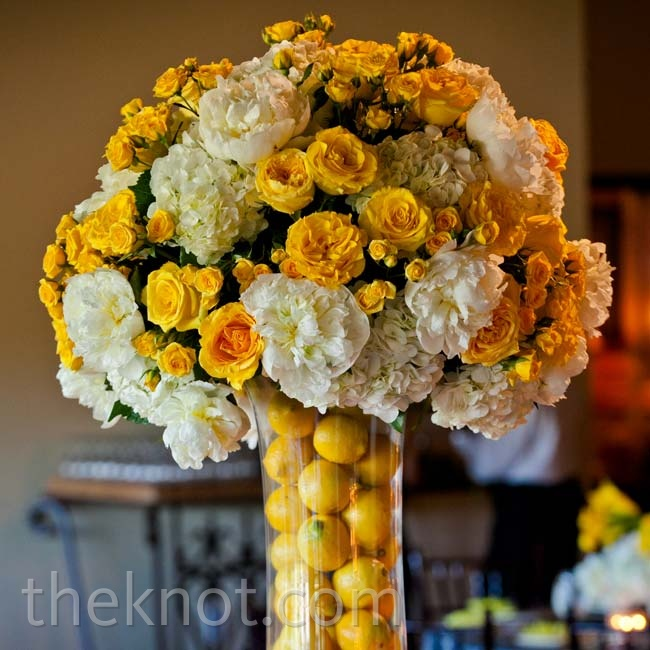 Lemon-filled vases brought even more color to the lush yellow-and-white arrangements.