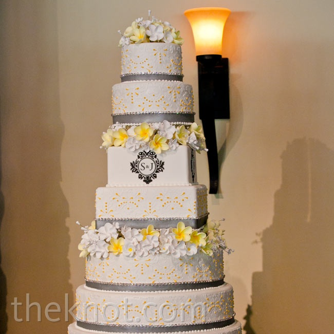 The whopping nine-tiered cake got some extra dazzle from a monogram, sugar flowers, and gray ribbon.