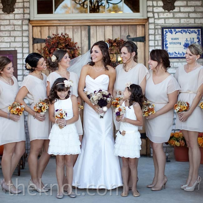 Flowy, short-sleeve dresses (Jessica stumbled upon them while shopping at Nordstrom) flattered all seven of the bridesmaids.