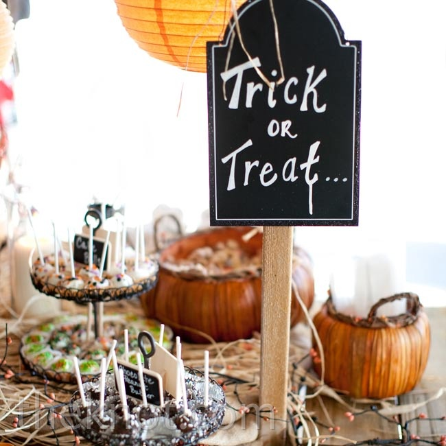 "Since the wedding date was close to Halloween, a ""Trick or Treat"" sign by the dessert bar was a no-brainer."