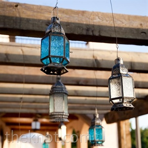 A few rustic glass lanterns brought some color to the wooden pergola, where guests sipped cocktails.