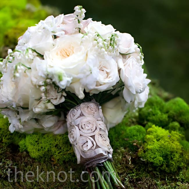 Ashley's white bouquet contained roses and lilies of the valley. A silk rosette ribbon added light texture.