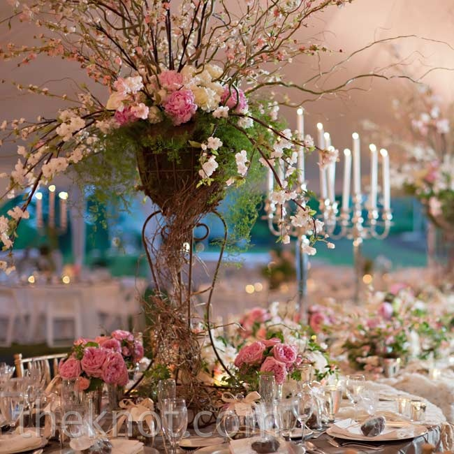 To get the look of an enchanted garden, the tables were decked out in woodsy peony and branch centerpieces with silver candelabras.
