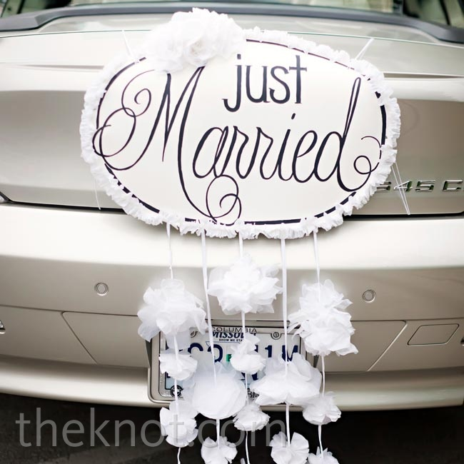 The newlyweds drove off in a silver convertible, complete with decorations on the rear bumper.