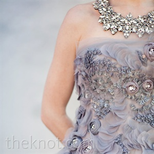 Rebecca handmade her necklace, which perfectly complemented the crystal detailing found on her dress.