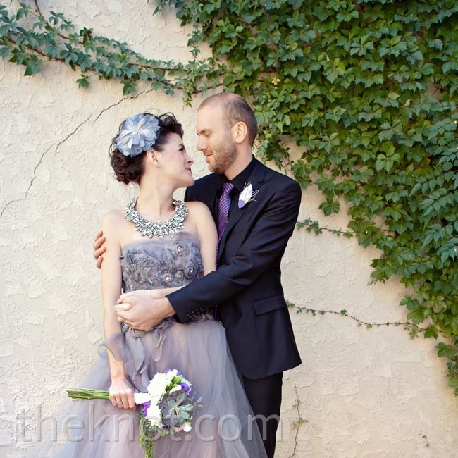 "A ""huge lover of fashion,"" Rebecca knew she had  to have this lilac-and-charcoal Vera Wang gown  when she spotted it  (in The Knot magazine!)."
