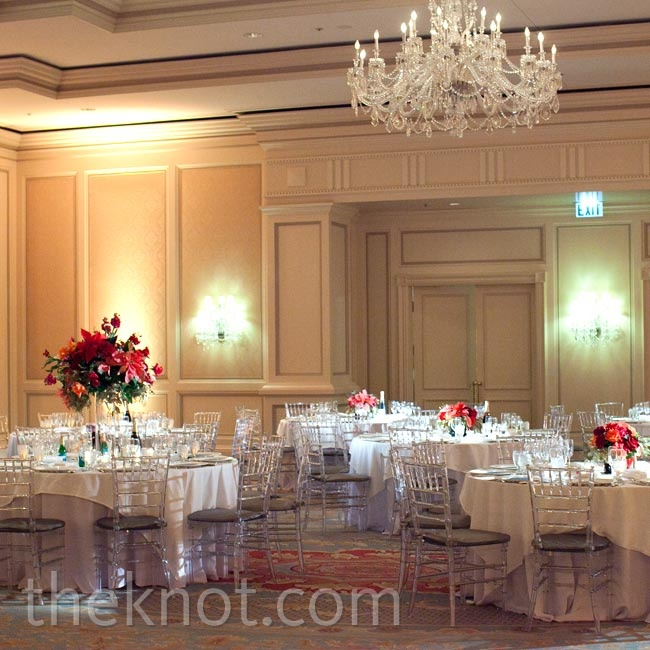 Tables topped with white linens and red centerpieces filled the regal ballroom.