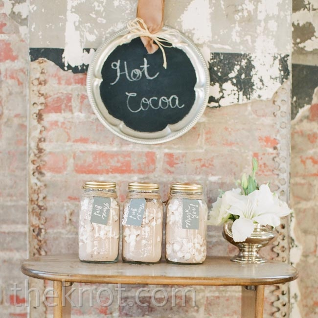 Mason jars filled with hot cocoa mix were a sweet homespun sendoff for guests.