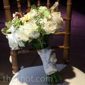 Alison carried a white-and-green bouquet of lady&#39;s slipper orchids, gardenias, lilies of the valley and roses.