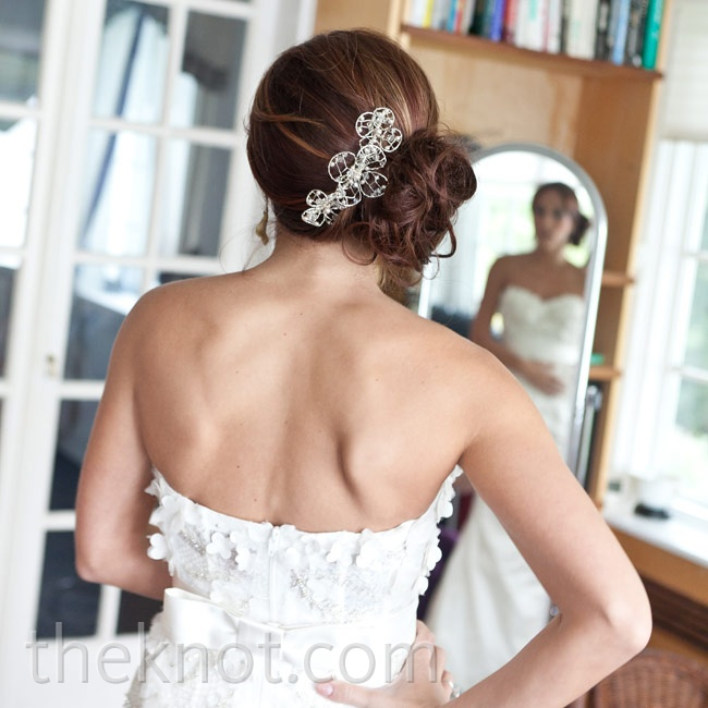 Alison wore her hair in a messy side updo with a delicate jeweled hairpiece.