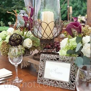 Antique-looking framed table numbers were nestled in with low centerpieces and large candle lanterns.