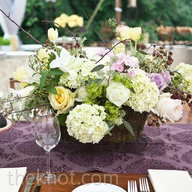 Ivory, soft-yellow and lavender garden roses, greens and hydrangeas were one of the many tablescape designs.
