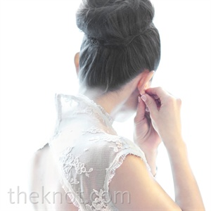 Beth pulled her hair up in an Audrey Hepburn-esque bun to show off her open-back lace gown.