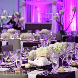 To keep their reception looking fresh, Beth and Josh went for modern, uncluttered tablescapes.