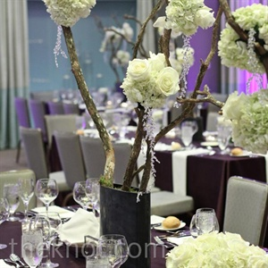 Tall branches were strung with loose white hydrangea, rose, and orchid pomanders.