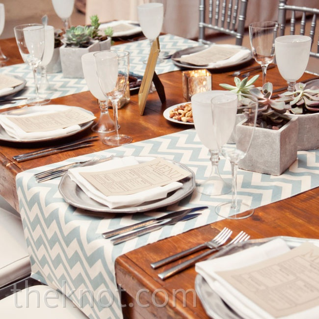 Pewter-and-white chevron table runners topped the exposed-wood reception tables.