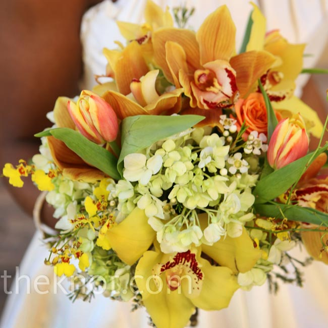 Asia carried a citrusy bouquet of orange tulips, yellow Oriental lilies, white wax flowers and cymbidium orchids for an exotic look.