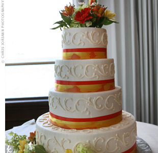 Piping, fresh flowers and patterned ribbon dressed up the all-white buttercream cake.