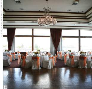 The large windows lining the restaurant walls let in lots of natural light, and the couple kept it casual with low floral arrangements on the tables.