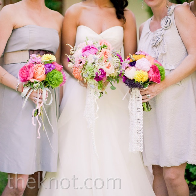 The bridesmaids carried cheery bouquets of pink dahlias, peonies, garden roses, and greens.
