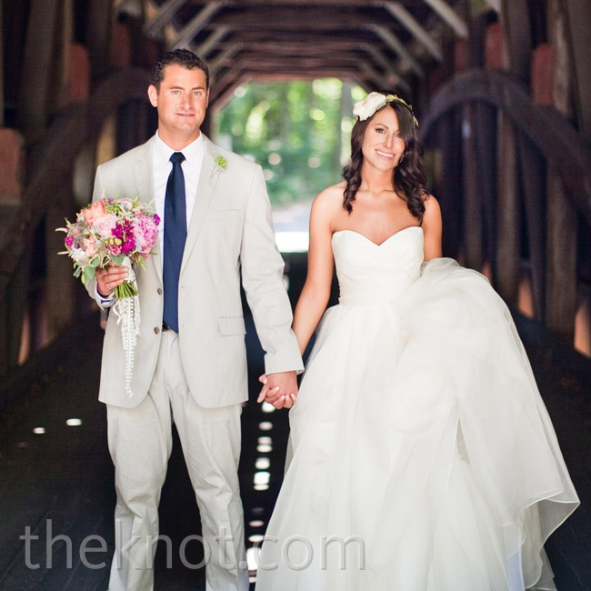 Jordan went with a light-gray suit and fun blue slip-ons, while Katie wore an airy strapless gown.