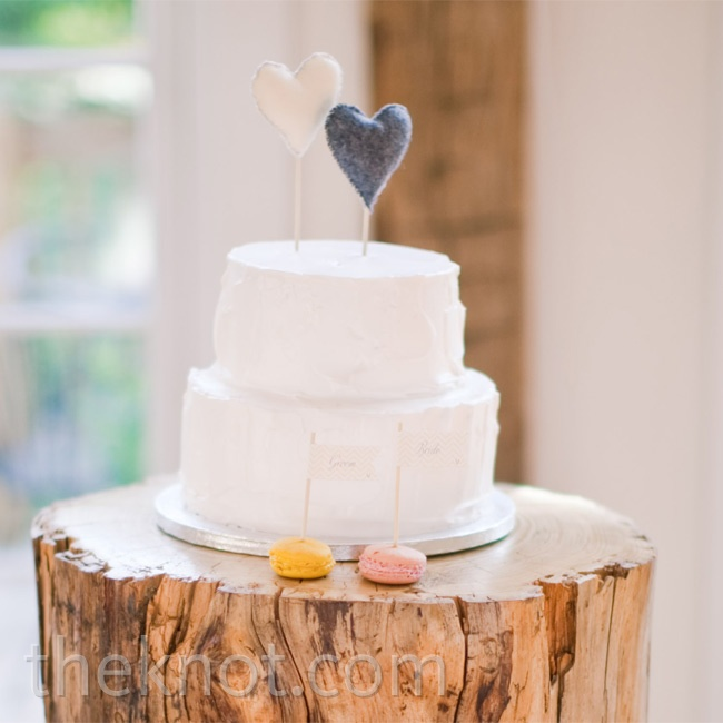 The couple's two-tiered whipped-frosting cake was topped with felt hearts.
