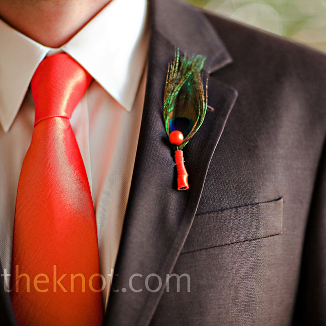 Tom wore a single peacock feather wrapped in orange ribbon for a nontraditional look.