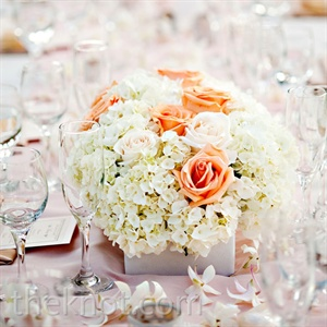 Simple, neutral arrangements topped the tables.