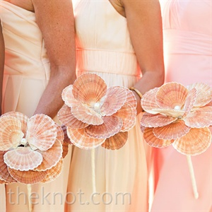 Zeina made bouquets for her bridesmaids out of big, scalloped seashells, which naturally fit the color palette.