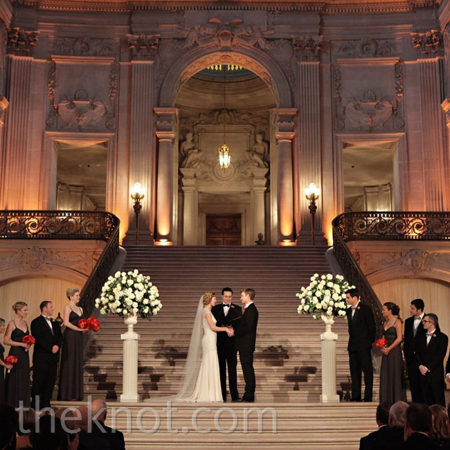 The ceremony took place in the rotunda, which was decorated with a few lush arrangements of white flowers.