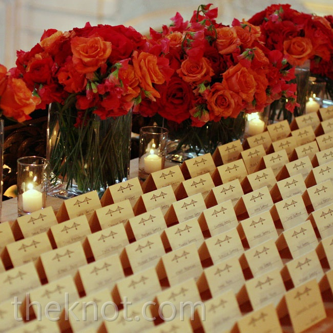 Tented cards, also with the Bay Bridge motif, were set out on a table in front of a row of red blooms.