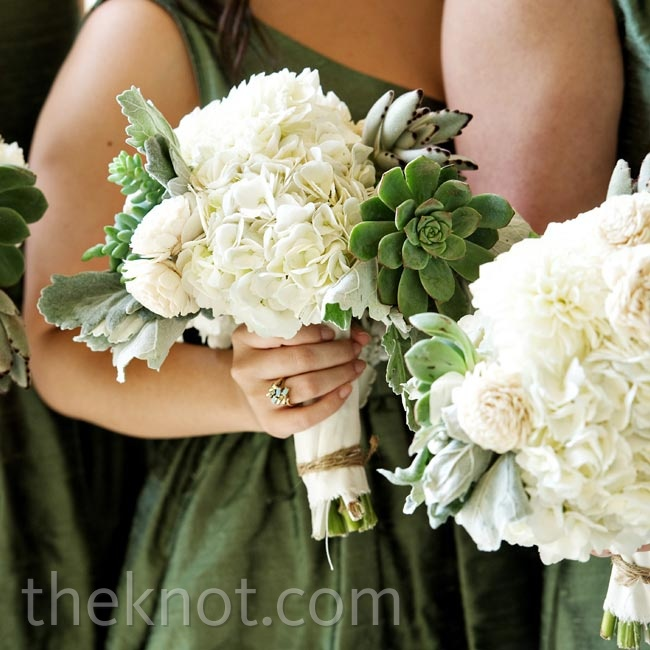 To match their sage-colored dresses, the bridesmaids carried white hydrangeas and green succulents.