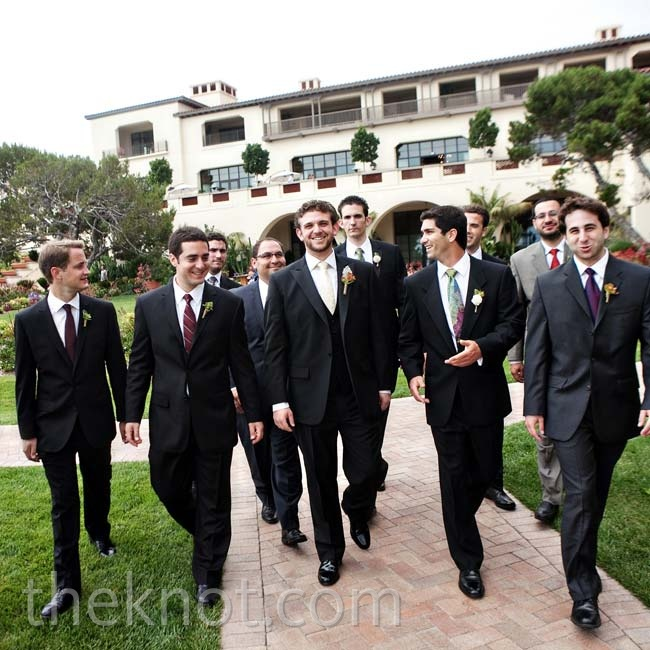 Greg and his groomsmen coordinated in black tuxes and different paisley ties.