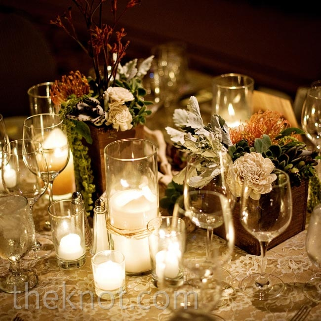 Soft candlelight and low arrangements of succulents and other blooms set a cozy tone.