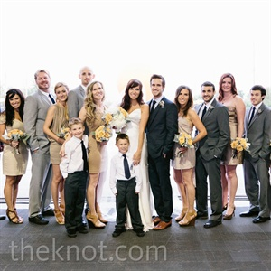 The bridesmaids wore their choice of a tan dress, while the groomsmen looked dapper in shades of gray.