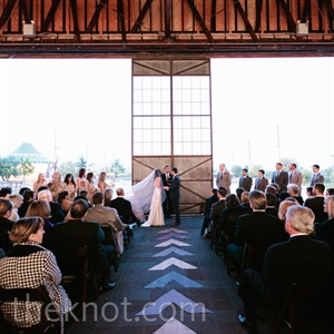 Lauren and Josh opened the large doors of their airplane-hangar venue for a fresh-air ceremony.