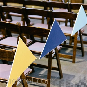 The ceremony chairs were decorated with bright, geometric triangles.