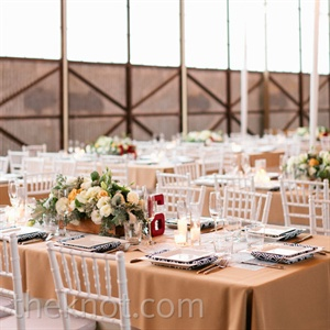 White chiavari chairs and burnt-orange linens created a clean, fun look.