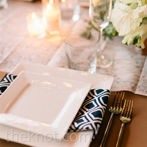 Graphic black-and-white napkins were wrapped around simple white china.