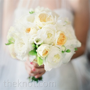 Lisa held a soft bunch of white peonies and pale-yellow English garden roses.