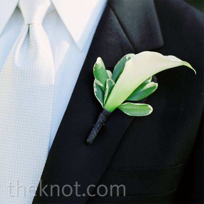 A single white calla lily bloom stood out against the guys' black suits.